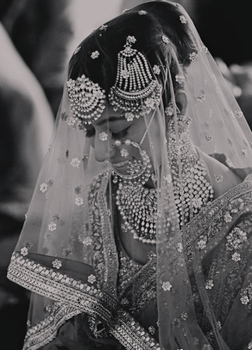 Stunning black and white shot of the bride in a veil Indian wedding   Curated by With Vows