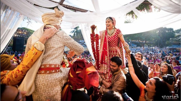 Indian Bride lifted by her brother for the jaimala