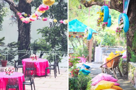 Paper pom poms and colourful seating ideas and lounges in an Indian outdoor Mehendi setting with tyres with flowers | Jonathan & Subhashree | Curated by Witty Vows