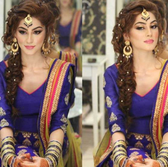 Indian wedding hairstyles for Indian Brides | loose side braid with beads | Natasha Salon