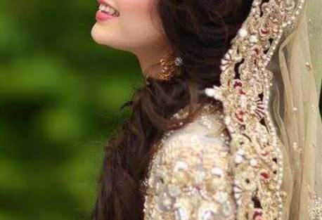 Indian wedding hairstyles for Indian Brides | center puff with sideswept twisted curls