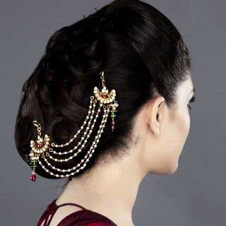 Indian wedding hairstyles for Indian Brides | heaped chignon bun with side accessory | Zarilane