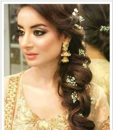 Indian wedding hairstyles for Indian Brides |Pretty side braid with curls with flowers in the hair | For the Mehendi - Image source bobhairstyleswithbangs | Curated by Witty Vows