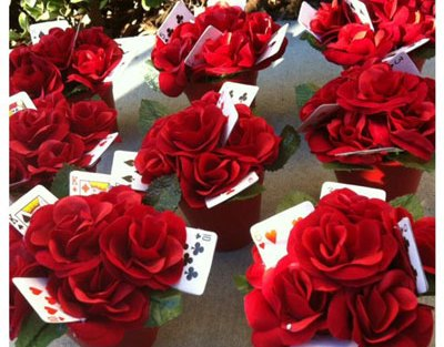 Red rose centrepieces with playing cards added in to give it height and some fun 'play'   ideas curated by witty vows for an amazing first diwali cards party for couples at home