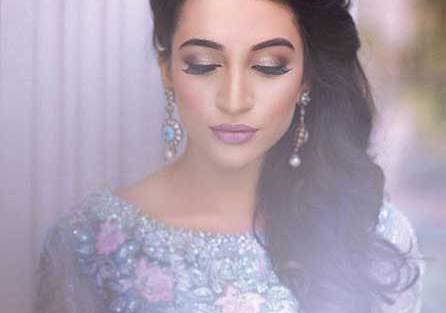 Indian wedding hairstyles for Indian Brides | Side swept curls on one side for the Indian engagement | Curated by Witty Vows