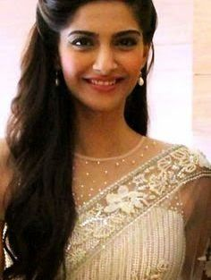 Indian wedding hairstyles for Indian Brides |Elegant loose curls on the side for long hair Indian bride for Sonam Kapoor | Curated by Witty Vows