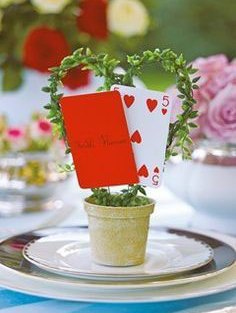 heart shaped potted wreath with playing cards on top for sweet table centrepieces in a card theme for your first diwali cards party as a couple