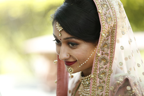 Anu weds Manu - a pretty day wedding in delhi| Indian Bride in an ombre ivory and blush peach lehenga with mint green accents and a mint green dupatta | pastel perfection | Bride wearing her kundan jewellery - maantika and nose ring | waiting for the baraat
