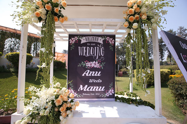 Anu weds Manu - a pretty day wedding in delhi  Pretty Indian Bride in an ombre ivory and blush peach lehenga with mint green accents and a mint green dupatta   pastel perfection   flower decoration and chalk board sign with couples names - Anu weds Manu