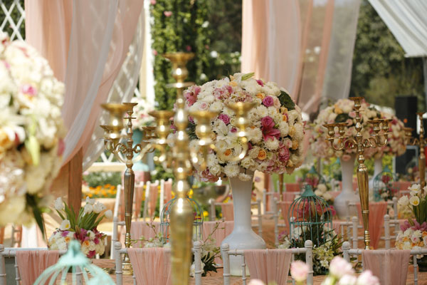 Anu weds Manu - a pretty day wedding in delhi| Pretty Indian Bride in an ombre ivory and blush peach lehenga with mint green accents and a mint green dupatta | pastel perfection | Soft peach and ivory canopies with white chivari chairs , cages and candelabras on tables with pastel flowers