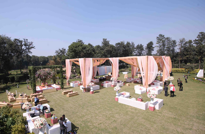 Anu weds Manu - a pretty day wedding in delhi| Pretty Indian Bride in an ombre ivory and blush peach lehenga with mint green accents and a mint green dupatta | pastel perfection | Soft peach and ivory drapes across the Garden wedding and a pretty trellis stage with greens