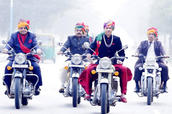 Indian groom entry ideas | Biker Baraat groom enters in on a motorcycle | Curated by witty vows