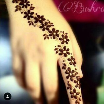 Minimal new mehndi design ideas for this wedding season | Henna Ideas | empty spaces Henna with flowers on back of the hand