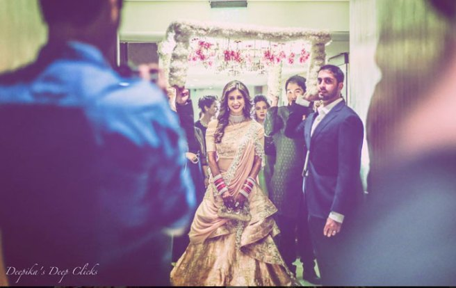 Indian Wedding Ideas from Suyyash and Kishwer's Wedding Reception | Kishwer in a peach & silver lehenga and suyyash in a white tux | peach of shoulder lehenga with pearl detailing | Pretty white and pink phoolon ki chaadar