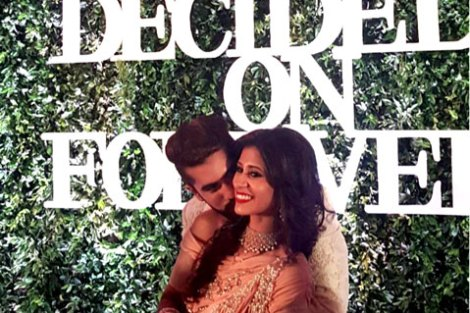 Indian Wedding Ideas from Suyyash and Kishwer's Wedding Reception   Kishtwar in a peach & silver lehenga and suyyash in a white tux   we decide on forever backdrop with letters white on green grass backdrop