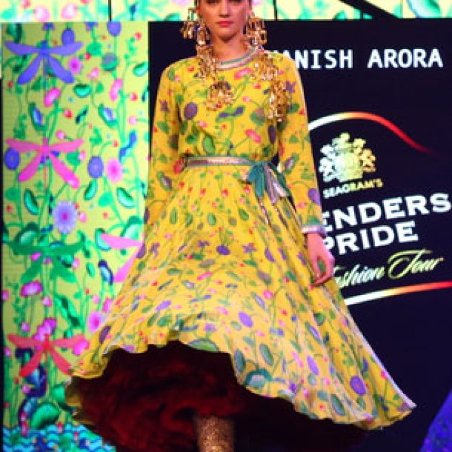 New Colourful Mehndi outfits for brides Yellow outfit with lotus motifs   Models walk the ramp at Manish Arora's collection 2016 Blender's Pride Delhi   Mehndi outfit Ideas to steal from Manish Arora's New Collection