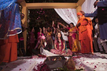 New Indian wedding ideas from VJ Yudi and Aditis Pretty Wedding | Yudhisthar and aditi laughing during the ceremony with a rose petal shower