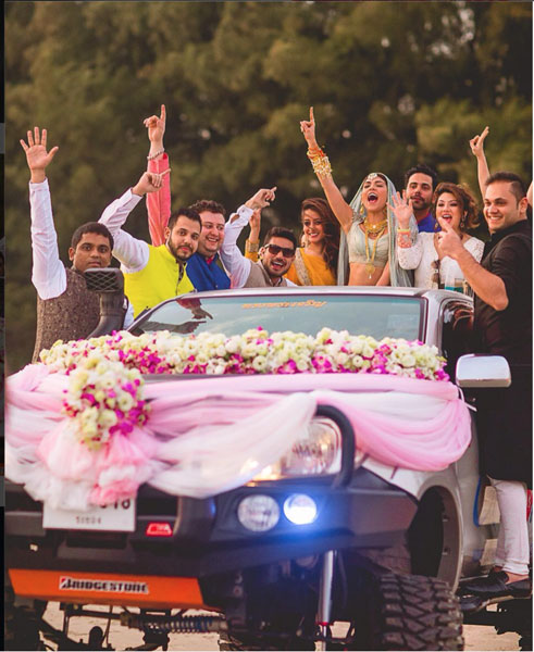 Groom and Bride exit ideas for Indian Weddings | vidai ideas | wedding send off ideas | couple exit ideas | Indian couple exit wedding groom and bride on a monster truck