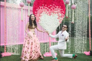 VJ Yudi and Aditi wedding in Delhi | Celebrity wedding ideas | Pretty Pink and ivory ombre rose studded heart with white Rajni strings on either side | Perfect for the proposal moment