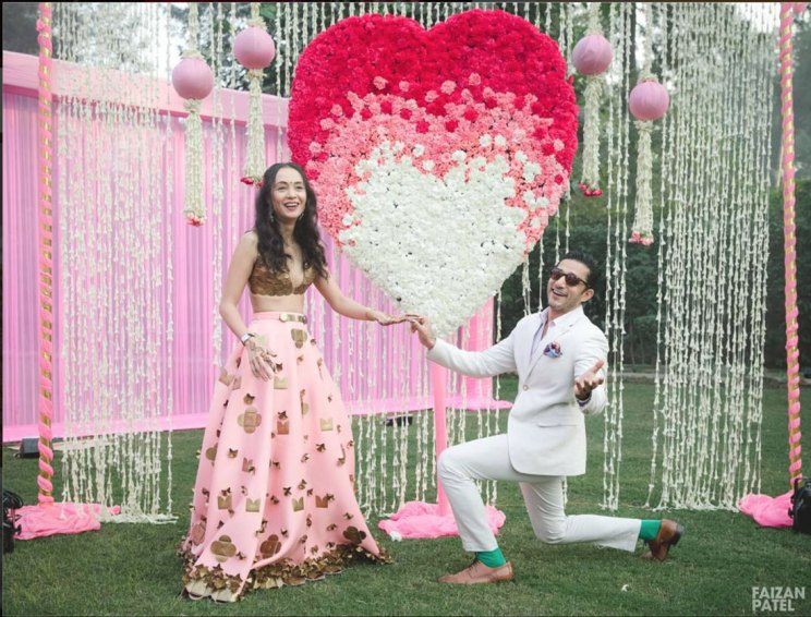 New Indian wedding ideas from VJ Yudi and Aditis Pretty Wedding | VJ Yudi and Aditi wedding in Delhi | Celebrity wedding ideas | Pretty Pink and ivory ombre rose studded heart with white Rajni strings on either side | Perfect for the proposal moment