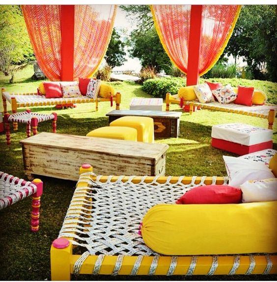 Indian Kitsch Mehndi Decor Ideas | Fun DIY Mehndi theme with super colourful Mehendi decor | Witty Vows | Colourful charpai seats with pretty colour blocked cushions