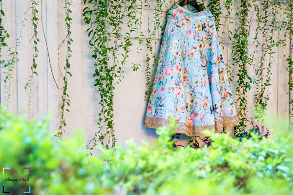 Indian wedding rentals | Luxury services on rent | Fashion on rent in India |vintage cars on rent, helicopter on rent, Pre wedding shoot locations | Pretty blue chintz floral print lehenga hanging | Shot by Anupa Shah Photography