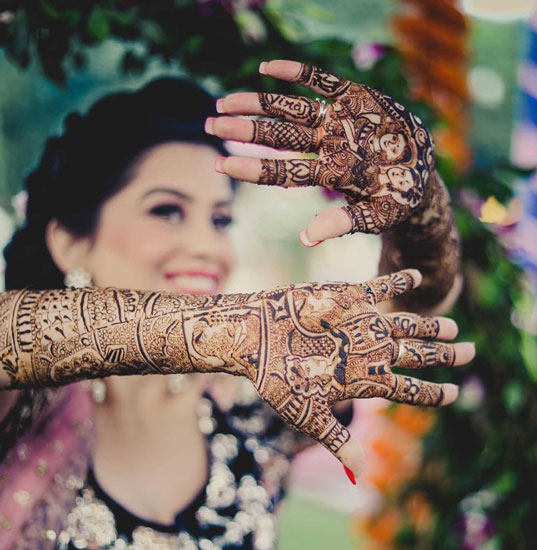 Bridal Mehndi ideas | new way to write the groom's name on the bride's hand | Groom's name on bride's ring finger in mehendi | New trending Mehndi designs | Photo by - More Images
