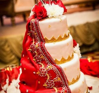 personalised wedding cakes | Indian Wedding Cakes | White cake with red dupatta matching the bride's dupatta with intricate detailing