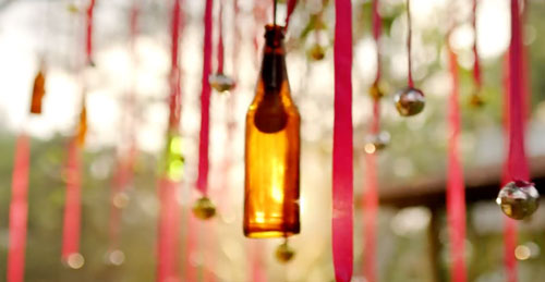 decor ideas from bollywood film Baar Baar Dekho | bollywood wedding | fun diy mehndi decor ideas | pink hanging ribbons shimmer silver balls | colourful bottles