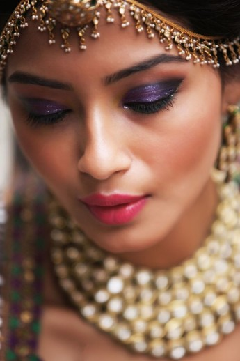 Top Indian Bridal Makeup trends | Makeup for bride | Getting ready photo | wedding look - Kundan bridal jewellery | pretty Indian bride with jewel toned makeup - pink ruby lips and violet eyes | Makeup idea | Photo by - House of Makeup