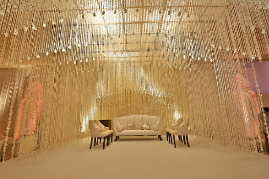 Sufi Night | Sangeet decor ideas | Free Sangeet Theme | decor ideas for sufi sangeet | mogra string decor | white flower strings hanging from the ceiling | pomegranate design | ivory stage for Indian wedding