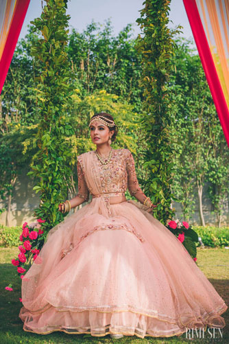 Mehndi jhoola and innovative mehndi decor ideas | beautiful mehndi swing bridal seat with greens and flowers like a fairytale dream | Rimi Sen photography