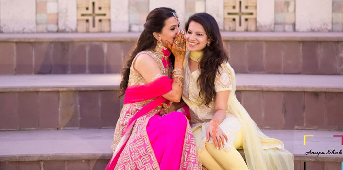 Indian bridesmaids duties | Bride's friends | BFF photos from Indian wedding | Bride gossiping with friend | whispering in her ear | Anupa Shah Photography