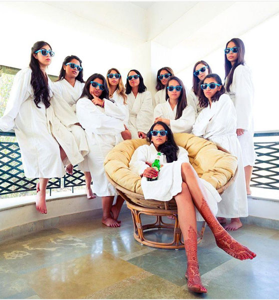 Indian bridesmaids duties | Bride's friends | BFF photos from Indian wedding | Indian Bride with her best friends in a robe and sunglasses | preach art (c)