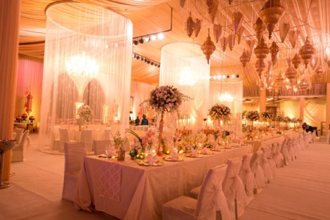 Ridhi Mehra's wedding photos | reception decor in ivory and gold | MOroccon lamps hanging with thread curtains