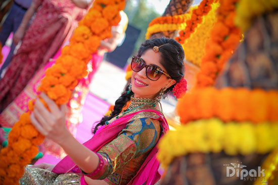 Sukriti and Amrit's Mehndi Function | Marigold decor | Indian bride with sunglasses