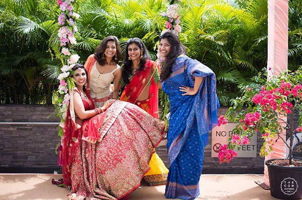 Indian bridesmaids duties   Bride's friends   BFF photos from Indian wedding   Indian bride and her friends on a swing with flowers   The con artists