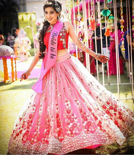 must have wedding pics for your wedding album | the bridal twirl photos | Indian bride in a pretty pink floral lehenga with a bride to be sash