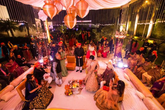 Ridhi Mehra's wedding mandap ivory vedi by the poolside with mirror pillars and flowers