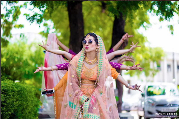 Indian bridesmaids duties | Bride's friends | BFF photos from Indian wedding | bride with sunglasses and friends posing with hand postures