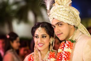 Ridhi Mehra wedding | Ridhi and akshay's Valentine's Day wedding | bride in pale pink Sabyasachi lehenga with Polki jewellery and groom in creme Rohit Gandhi sherwani