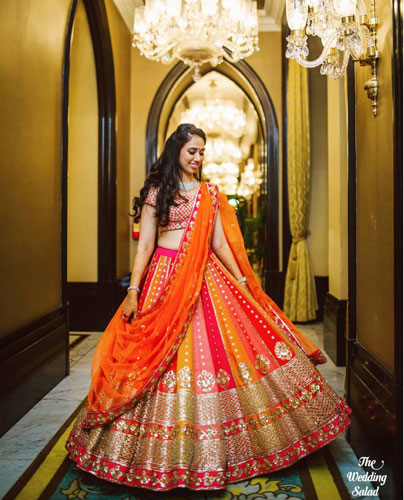 must have wedding pics for your wedding album | the bridal twirl photos | Indian bride in a pretty red orange yellow and pink multicolour lehenga with gold work
