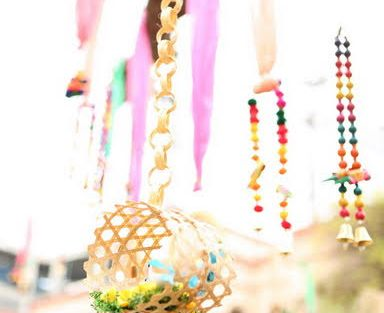 Pretty Kitsch Mehndi decor ideas |fresh Mehndi ideas | colourful yellow and pink birds decor in cane baskets hanging from the ceiling