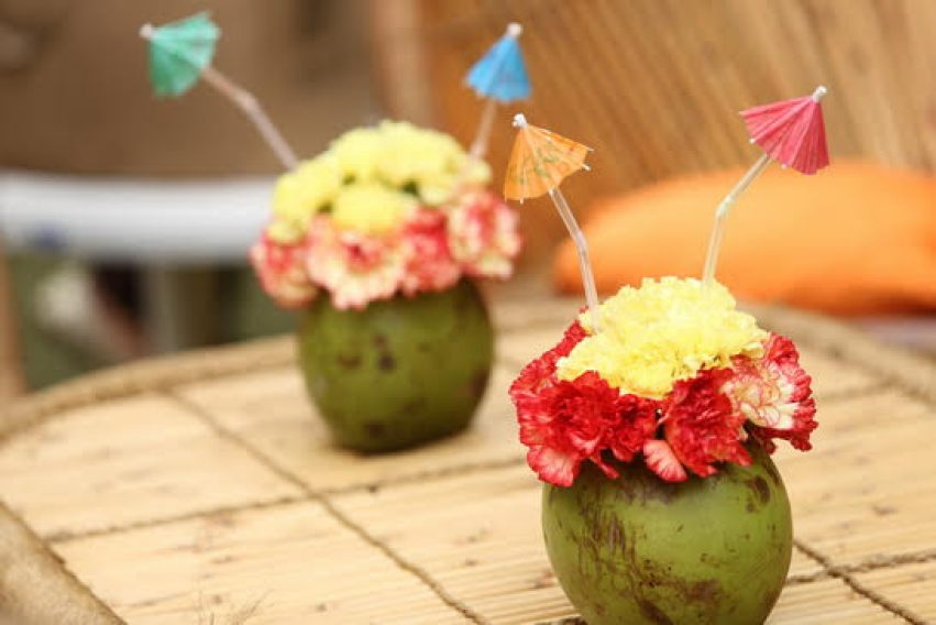Fun Mehndi centrepiece ideas | Coconuts with flowers and cocktail straws