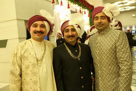 bride's father and uncles wearing ivory and Burgundy saafas matching