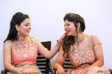 Indian bride wearing a peach and gold gown in two pieces with a crop top for her reception/ cocktail night