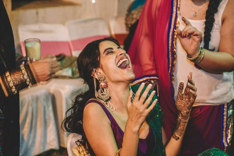 Indian bride laughing at her mehndi | Kundan vintage heirloom earrings with pearl kanauti