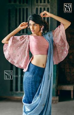 Latest blouse styles | new blouse styles to love | latest blouse designs for Indian brides | Pale pink blouse with bell sleeves and a blue half drape saree