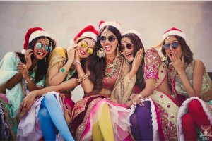 Indian bachelorette destination ideas | Indian bride fun photo with bridesmaids | Bride and bridesmaids in lehengas with sunglasses and Santa caps | Morvi images