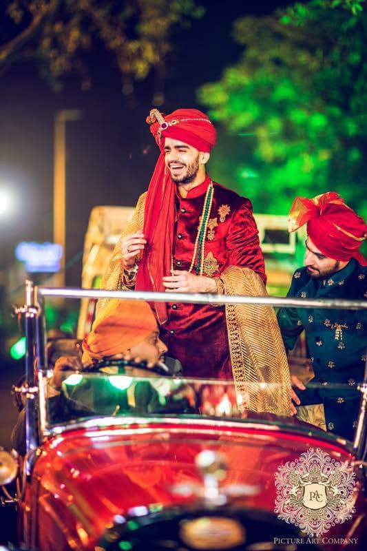 Indian wedding | Delhi wedding with a vintage car for the baraat | groom in a vintage car | royal wedding feels | Kshitij on a red vintage car in red sherwani